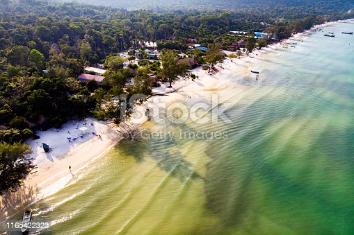 istock Sand on whitebeachr top view background, copy space texture for holiday design background. Coast of island Koh Rong Samloem, Cambodia. 1165422323