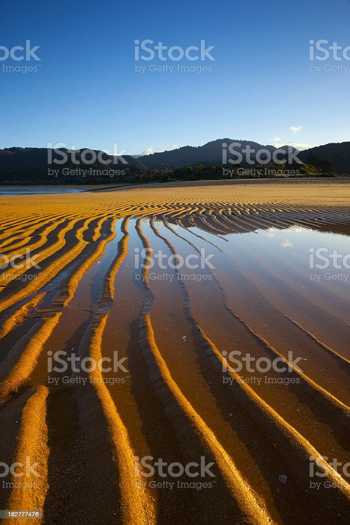 Sand patterns at the beach stock photo