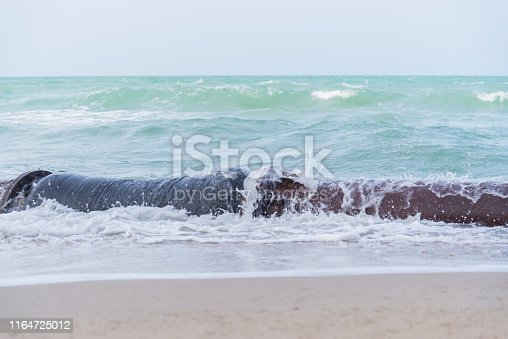 Sand pipe suction on the beach