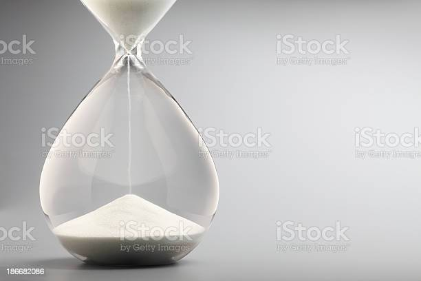 Sand pouring into bottom of hourglass on gray background picture id186682086?b=1&k=6&m=186682086&s=612x612&h=uxoxjepghrkuwea2c u7axce2z5ojbzapo7imi8krxs=