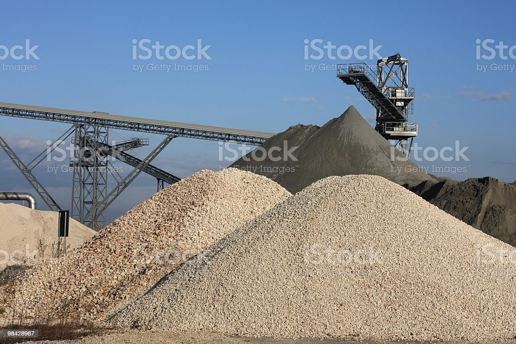Sand quarry with excavator royalty-free stock photo