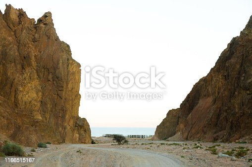 a picture of the dirt road in the mountains  that leads to the red sea in the sinai desert
