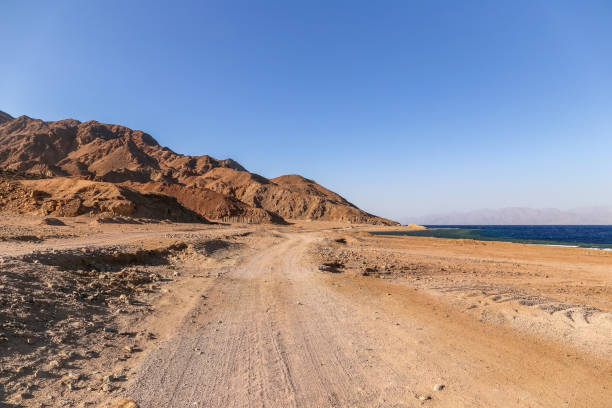Sand road near the costline of Red Sea in Dahab. Egypt stock photo
