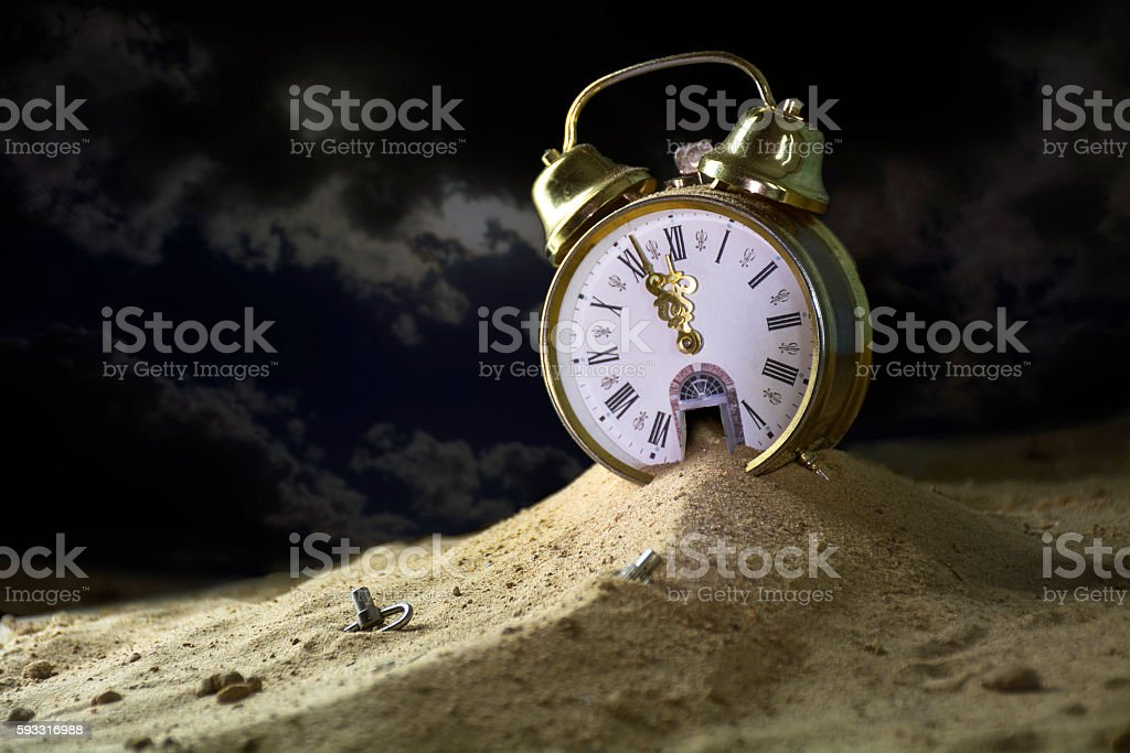 sand running from an alarm clock at night, insomnia concept stock photo