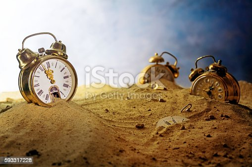 istock sand running out of an alarm clock, time concept 593317228