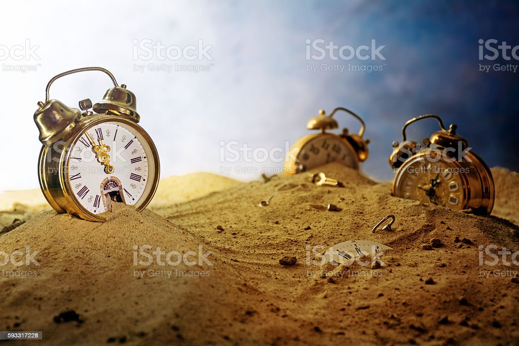 sand running out of an alarm clock, time concept stock photo