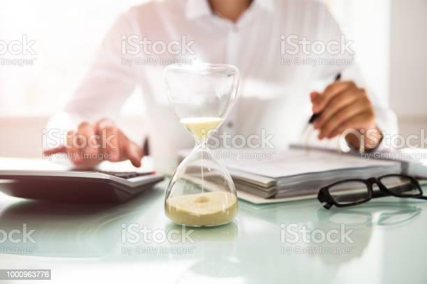 Sand running through the bulbs of an hourglass picture id1000963776?b=1&k=6&m=1000963776&s=612x612&h= ljocbzteisrgtes6evxkpqtg8cevd57klsnzkdc35o=