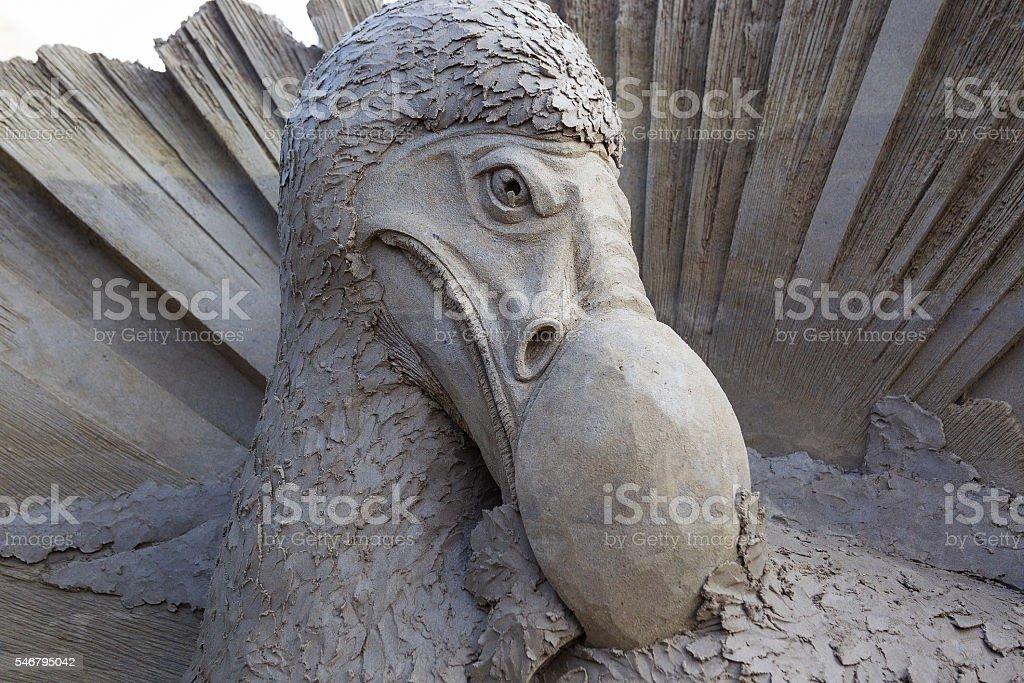 Sand sculpture of a portrait of the extinct flightless Dodo. stock photo