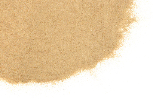Overhead shot of flat sand texture background.