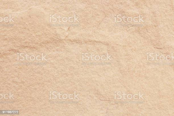 Photo of sand stone wall texture in natural pattern with high resolution for background and design art work.