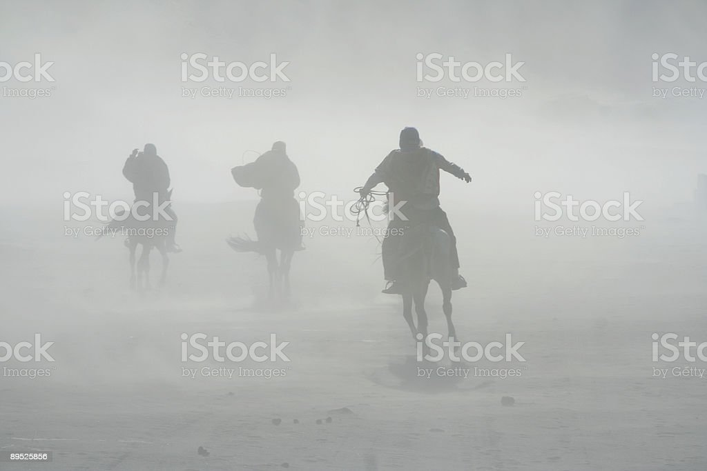sand storm horse riders mount bromo royalty-free stock photo