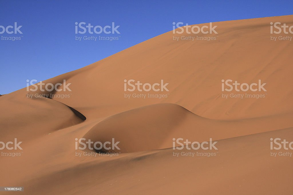 Sand sune in Africa with natural wave patterns stock photo