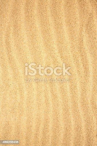 678719470 istock photo Sand texture background 486058438