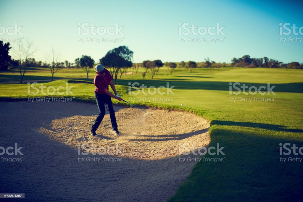 Sand traps are no match for his skill stock photo
