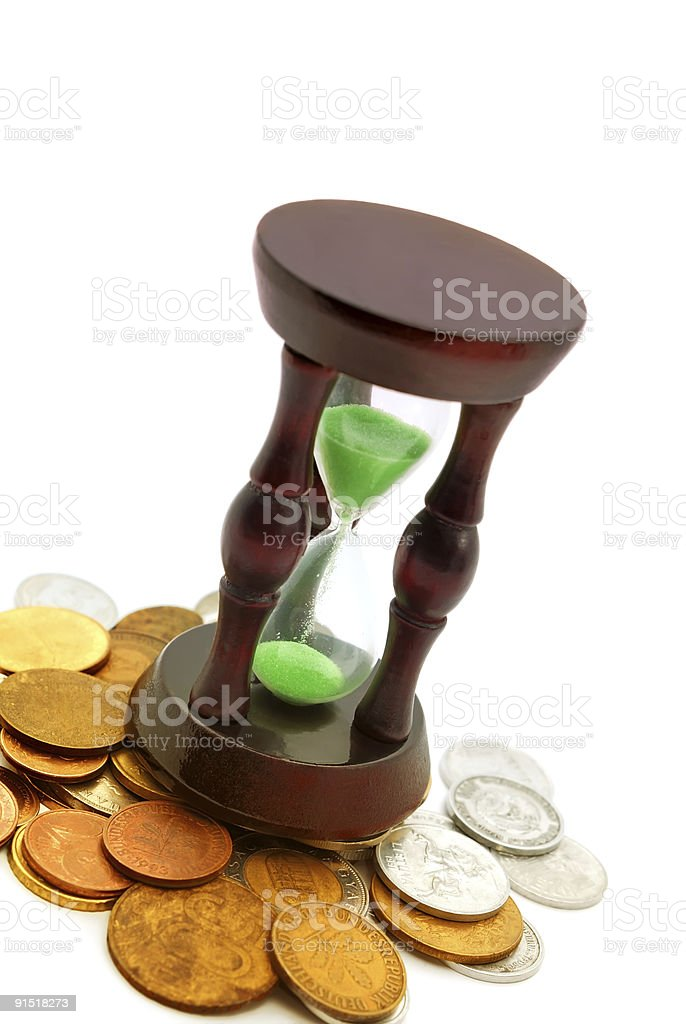 sand watch and background of coins stock photo