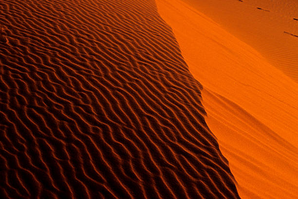 Sand waves before the fall stock photo