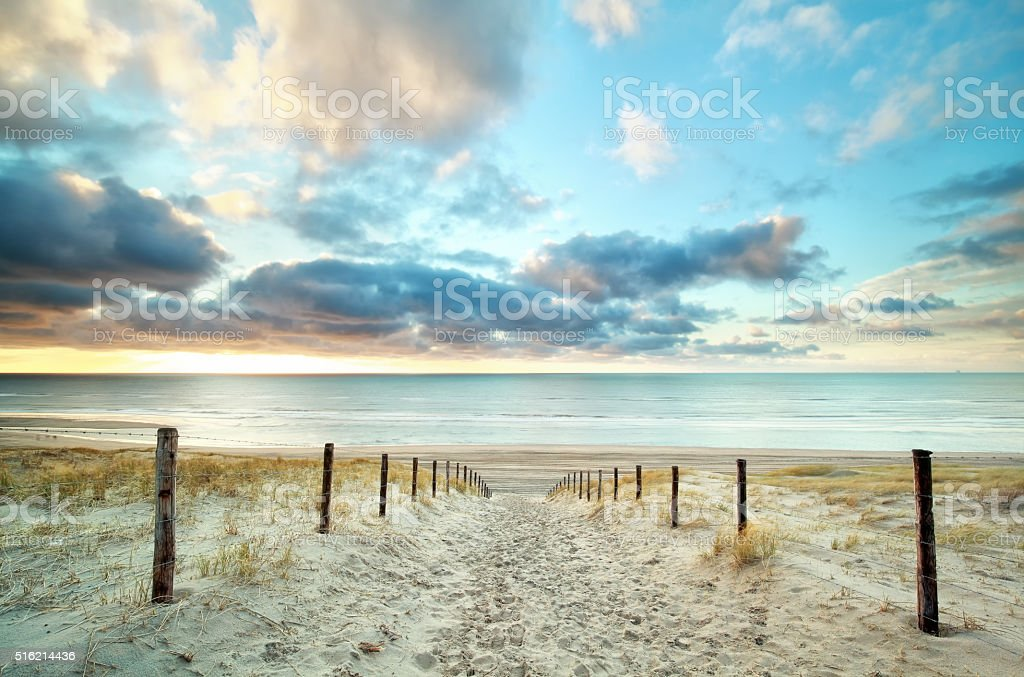 sand way to the North sea beach stock photo