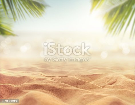 istock sand with blurred sea sky background, summer day 673935880