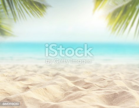 istock sand with blurred sea sky background, summer day 688359030