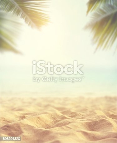 istock sand with blurred sea sky background, summer day 696504320
