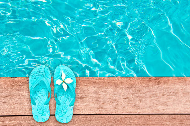 Sandals by a swimming pool, summer concept stock photo