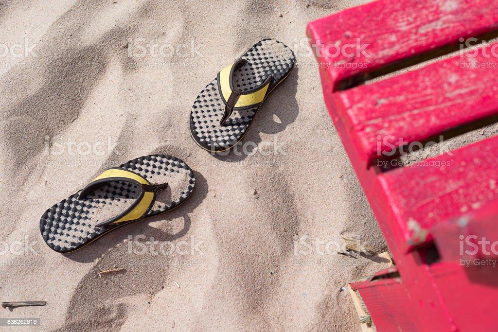 Sandals forgotten on the beach stock photo