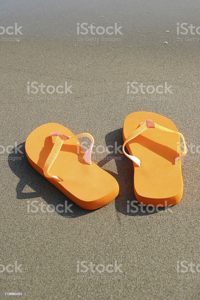 Sandals in the sand royalty-free stock photo