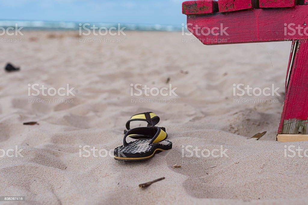 Sandals left on the beach stock photo