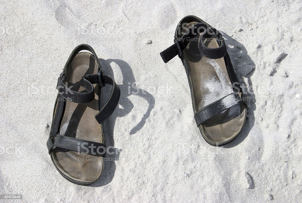 Sandals on sand royalty-free stock photo