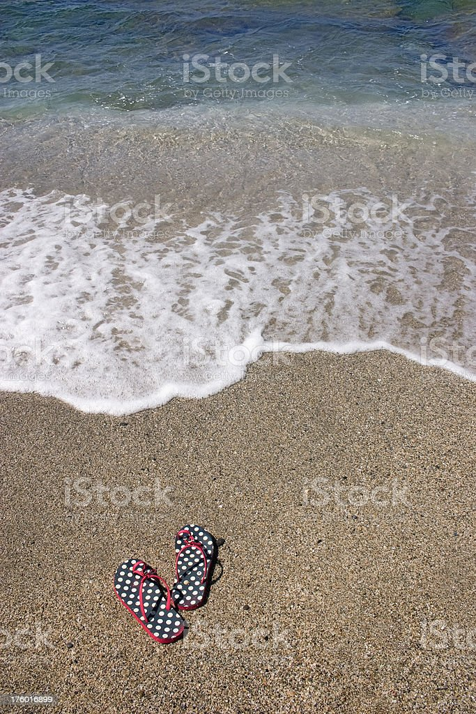Sandals on the beach royalty-free stock photo