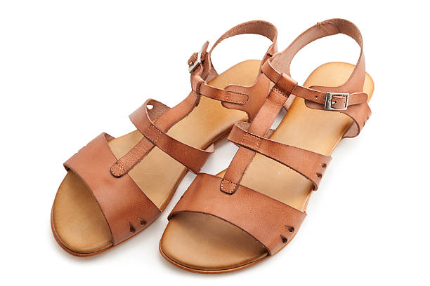 sandals - flat shoe stock photos and pictures
