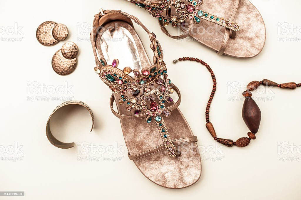 Sandals with accessories in boho style isolated on white - foto de stock