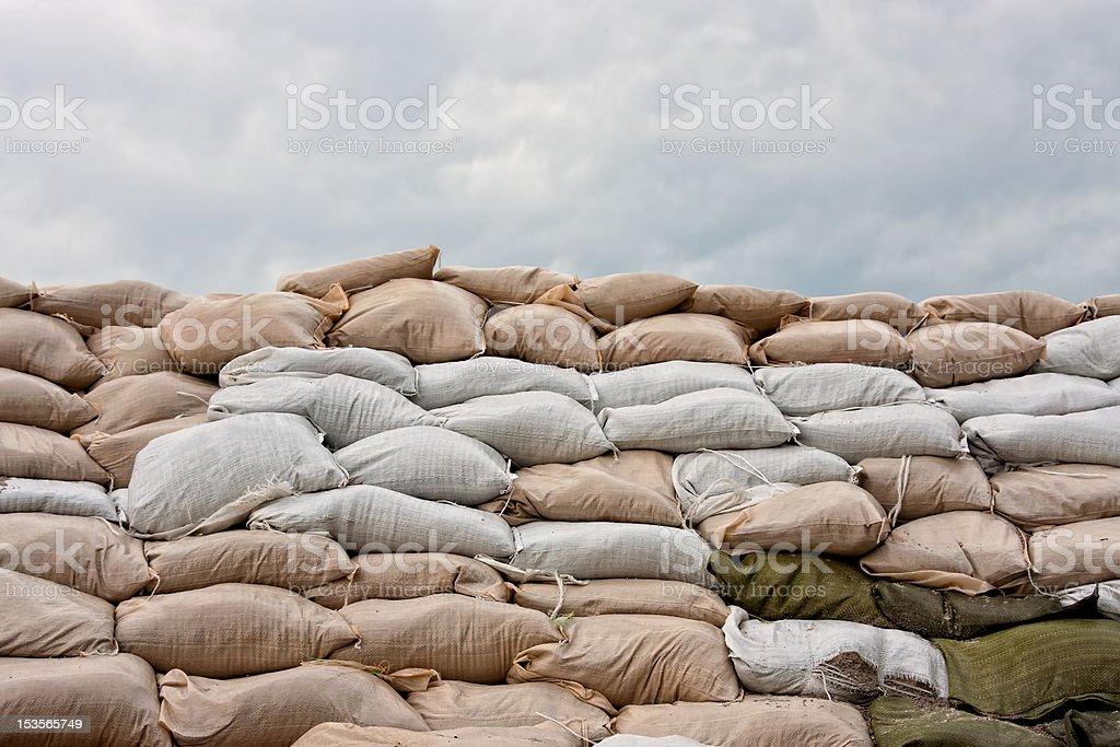 Sandbag Levee with Stormy Sky stock photo