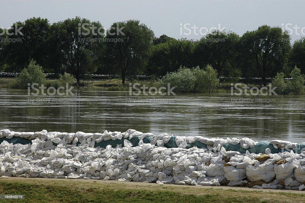 Sandbags against floods on a river bank stock photo