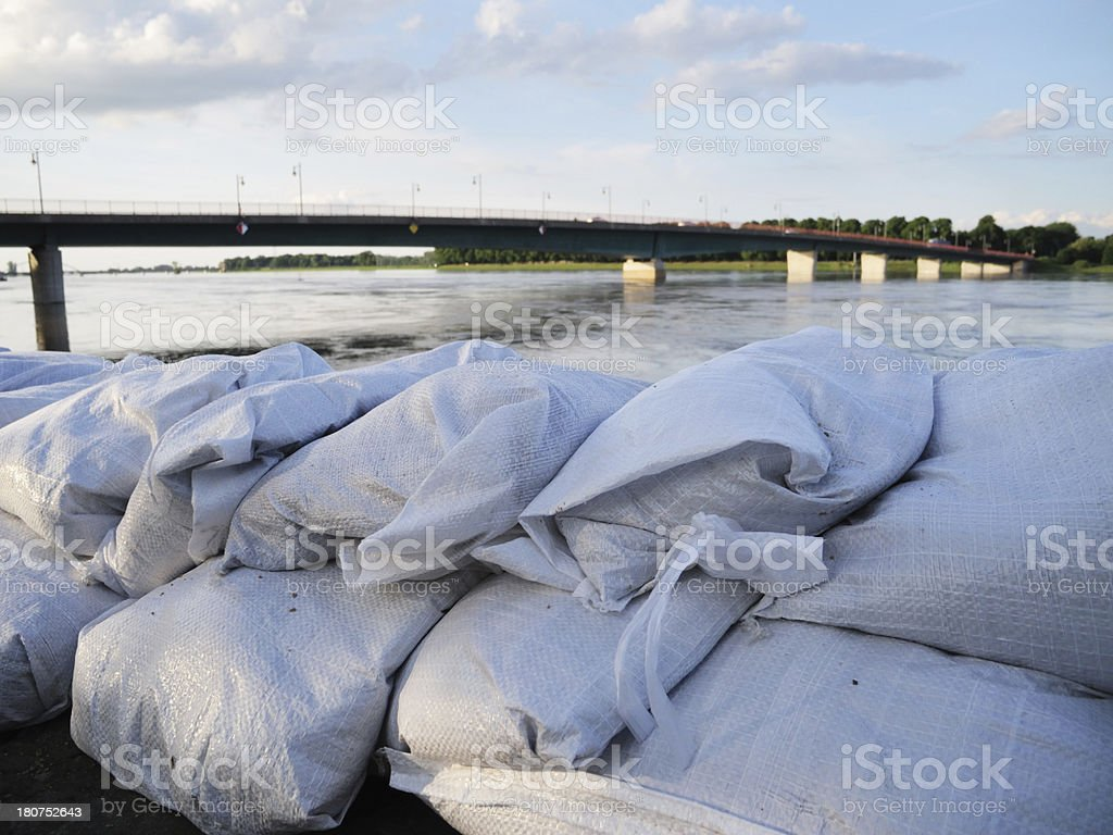 sandbags in front of flood water stock photo