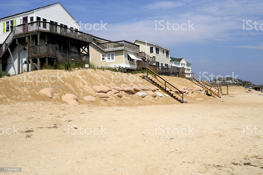 Sandbags on the beach stock photo