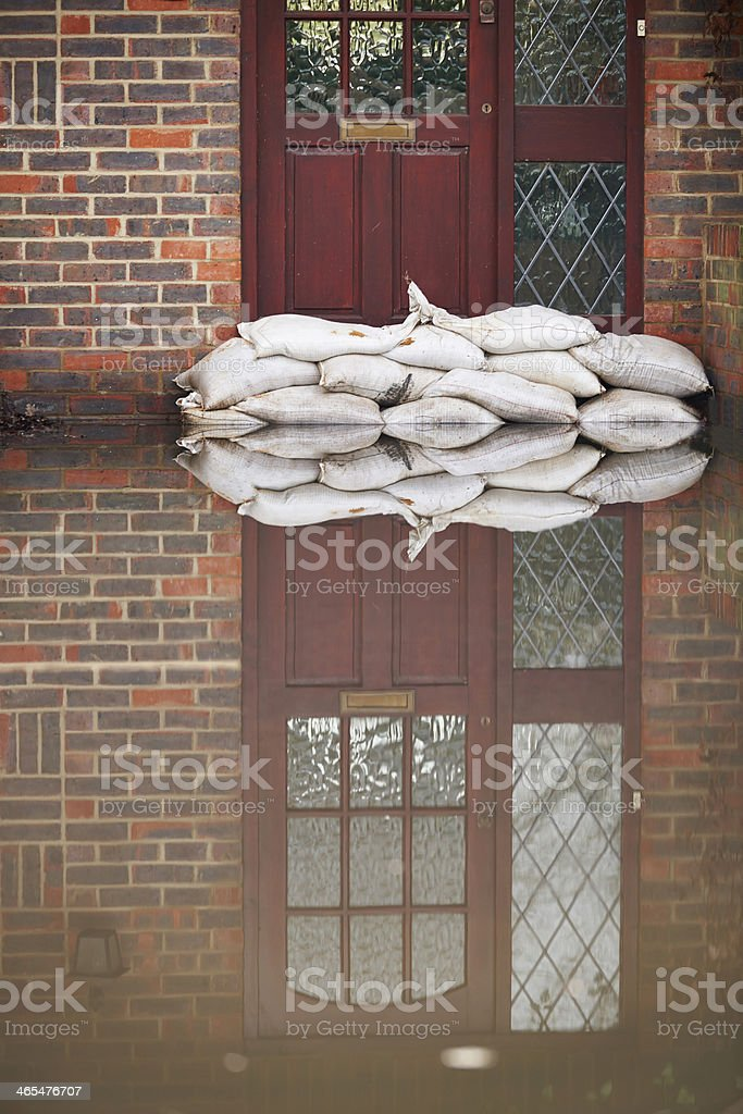 Sandbags Outside Front Door Of Flooded House stock photo