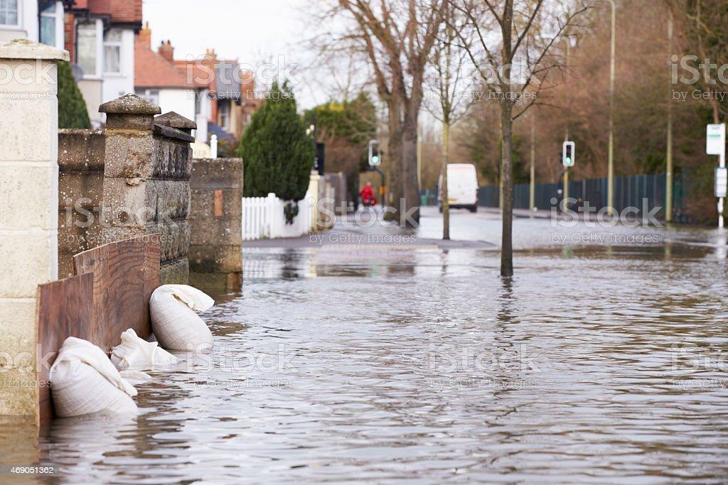 Sandbags Outside House On Flooded Road stock photo