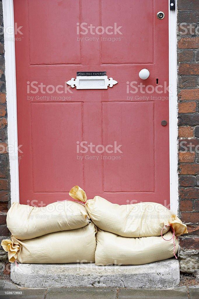 Sandbags Stacked In A Doorway stock photo