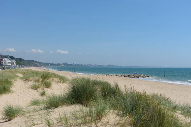Sandbanks beach with the dunes and Bournemouth in the distance stock photo