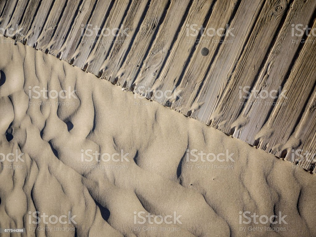 Sand-beach with Wooden Boardwalk Texture Background royalty-free stock photo