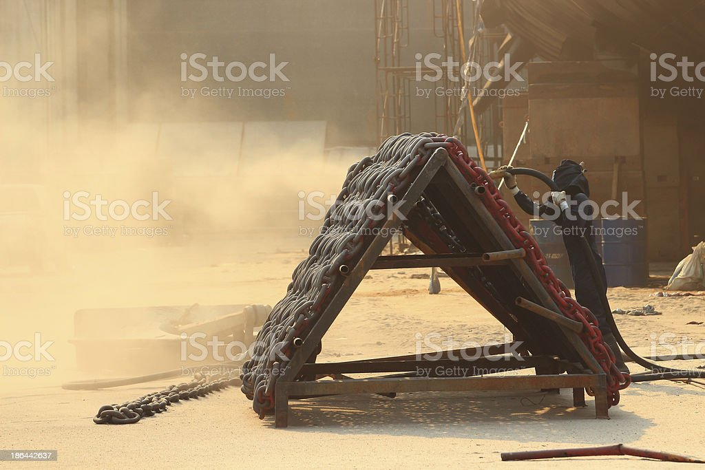 Sandblasting  inject Chain  in dry dock royalty-free stock photo