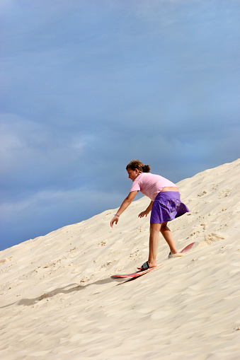 Sandboards and dunes at Joaquina beach in Florianopolis-SC, Brazil.