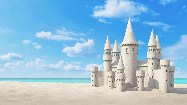 château de sable sur la plage brillant sky. 3 d représentation - chateau de sable photos et images de collection