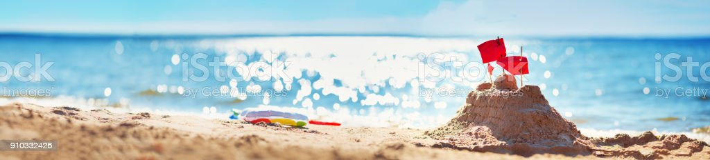 Sandcastle on the sea in summertime stock photo