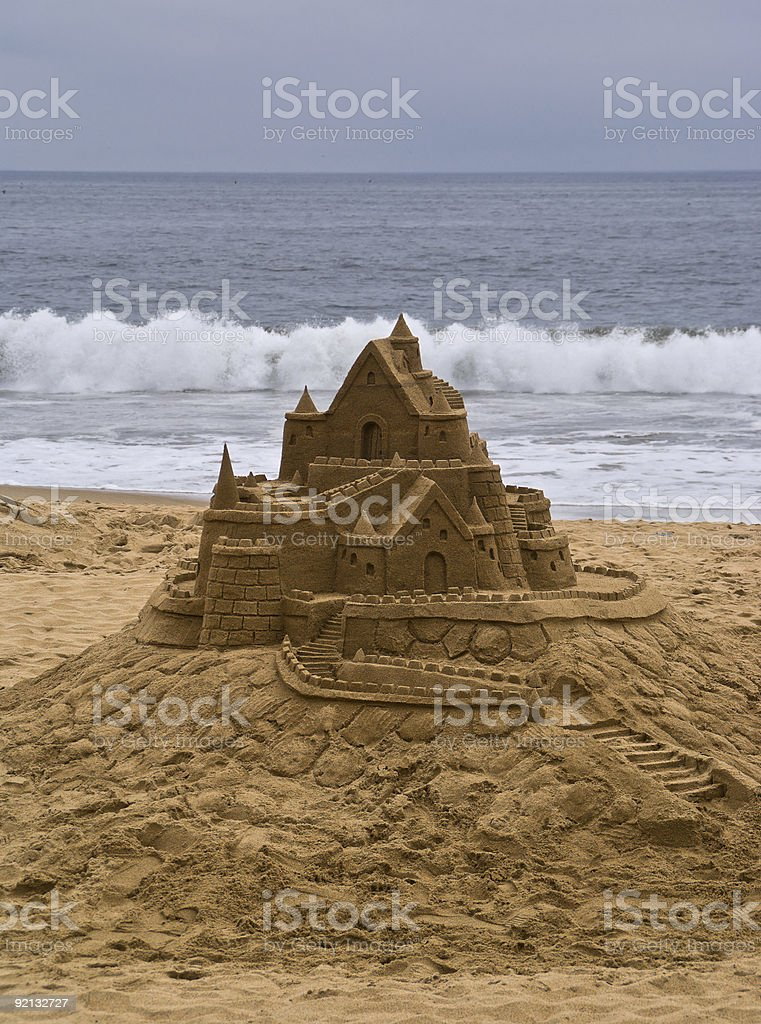 Sandcastle the beach, with ocean in background. royalty-free stock photo