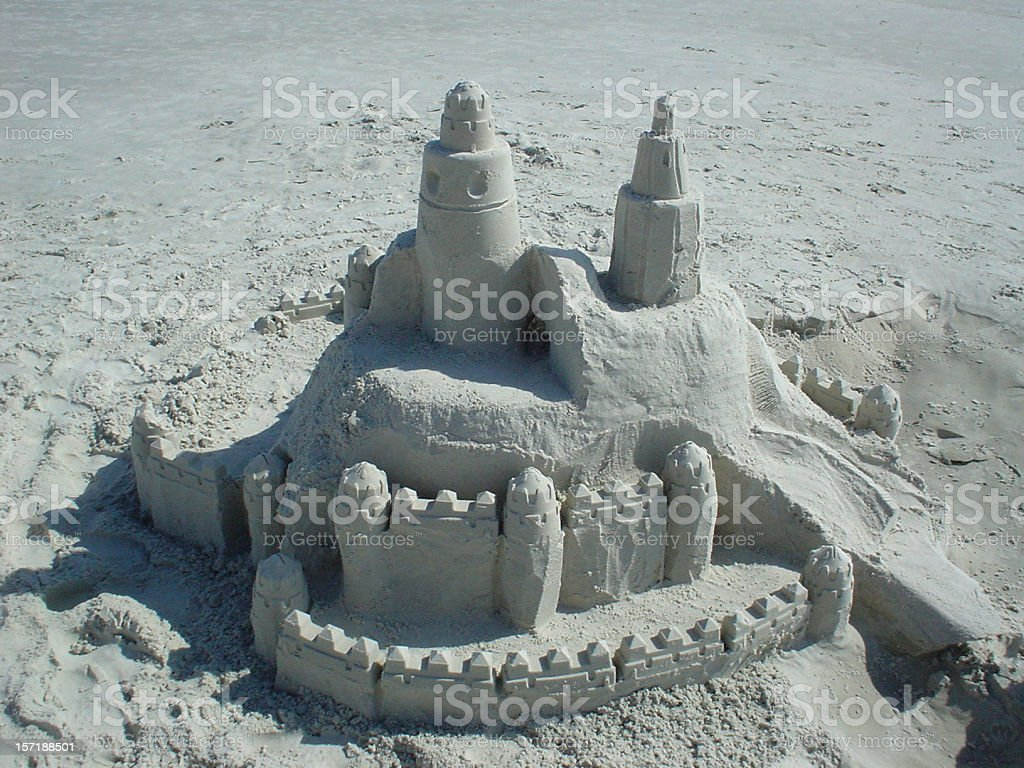 Sandcastle with detailed walls stock photo