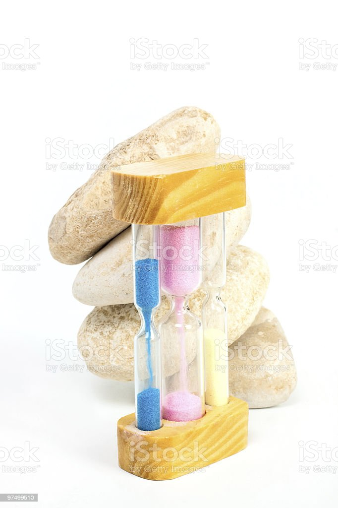 Sand-glass and stones royalty-free stock photo