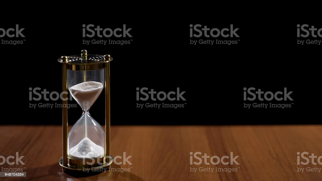 Sandglass measuring time by sand flow, life passing quickly, time...