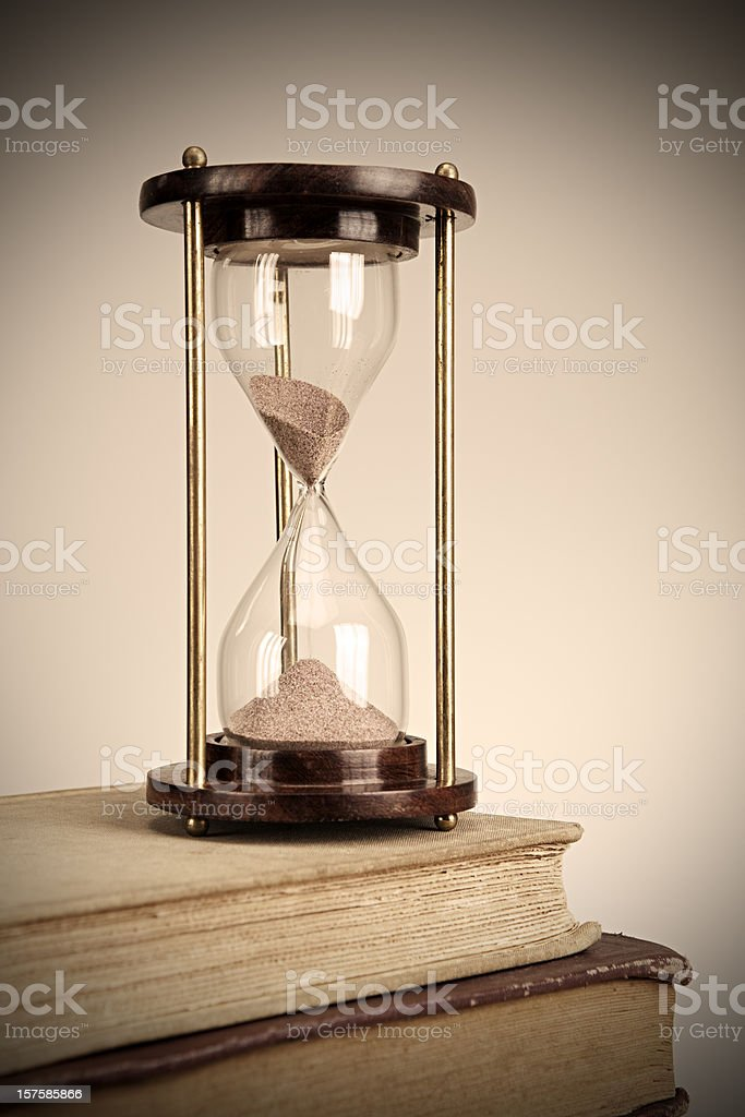 Sandglass on Books stock photo